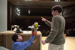 """Skye Ozga (left) provides movements for Audrey II while Seymour, played by Jackson Hajer, tempts the plant with his finger during a rehearsal of """"Little Shop of Horrors"""" at Hauser Junior High in Riverside in March."""