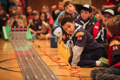 Isaiah Barnes, 8, examines the track before the start of Pack 24 Cub Scouts' annual pinewood derby at Riverside Presbyterian Church on Saturday 24, 2015.   CHANDLER WEST/Staff Photographer