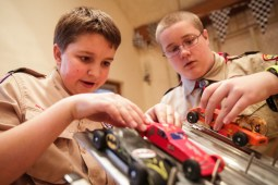 (From left) Joseph Connelly, 15, and Ryan Cornelius, 13, load cars onto the track before a race in Pack 24 Cub Scouts' annual pinewood derby at Riverside Presbyterian Church on Saturday 24, 2015.   CHANDLER WEST/Staff Photographer