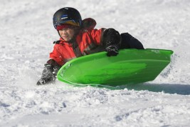 Ethan DiMaano, 10, shreds his way down the sled hill at Swan Pond park on Monday, February 3, 2015. | CHANDLER WEST/Staff Photographer