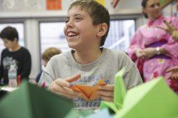 Fifth-grader Brandon Tennicott folds an origami crane during Brook Park Elementary School's Annual Cultural Week, on Friday, January 30, 2015. | (Chandler West/Staff Photographer)