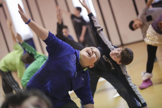 Fifth-grader Joseph Riina practices yoga with his classmates, during Brook Park Elementary School's Annual Cultural Week, on Friday, January 30, 2015. | (Chandler West/Staff Photographer)