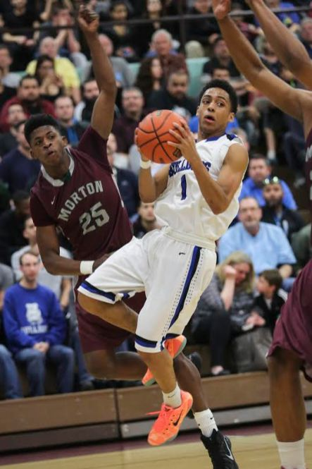 RBHS junior point guard Daniko Jackson, center, looks for a teammate to pass to under defensive pressure from Morton senior Dexter Dale. (Chandler West/Staff Photographer)