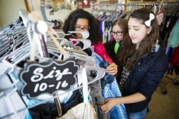 Eight grader Natalia Valenzuela (right), along with friends Delaney O'Brien and Isabella Mullins, shop at the RB Boutique, a pop-up shop where where girls could purchase gently worn dresses, shoes and accessories, held at Hollywood House, 3435 Hollywood Avenue in Brookfield on Saturday, March 21, 2015. The event was hosted by the Riverside Brookfield High School PTO. | CHANDLER WEST/Staff Photographer