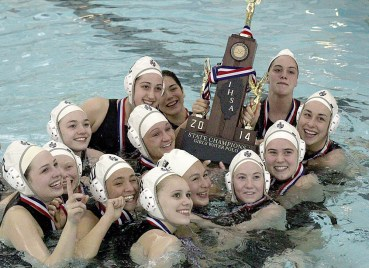 The Fenwick girls water polo team celebrates in the pool after defeating St. Ignatius 6-3 in the 2014 state finals. (File photo)
