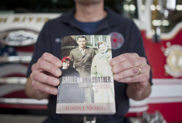Solemn story: Austin Nicholl was introduced to the story of Tim Fitzmaurice by his brother-in-law, who was the late Marine's best friend. The project took more than two years to complete. | William Camargo/Staff Photographer