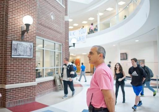 Always visible: John Passarella patrols the halls at RBHS on May 15. | William Camargo/Staff Photographer