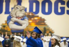 A graduating senior of Class 2015 waves at family and friends during the commencement ceremony at Riverside-Brookfield High School May, 22.   Ting Shen   Ting Shen/Contributor