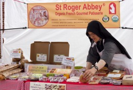 Sister Mary Valeria of St. Roger Abbey, Vernon Hills,IL., arranges pastries at the Brookfield farmers market on Saturday, June 13, 2015. |Photo by Jennifer T. Lacey