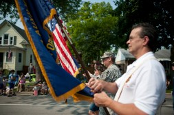 Members of the military from Brookfield participate in the annual 4th of July parade in Brookfield on July 4, 2015. Weather was enjoyable and candy was thrown out to children who attended the parade.