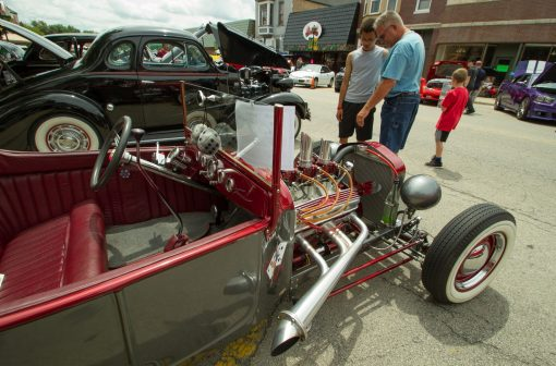 Jim Bergthold, right, talks with his son David, left, about engine design on a 1923 Ford Roadster.   Jennifer T. Lacey/Contributor