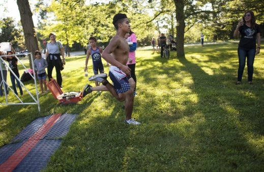 Angel Cepeda goes neck to neck with another participant. | William Camargo/Staff Photographer