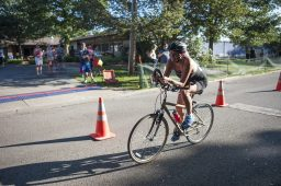 Tara Gregus cycles down the street during the bike section. | William Camargo/Staff Photographer