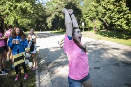 Abby Schwarz cheers on the participants. | William Camargo/Staff Photographer