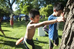 Ian and Ethan Dimaano, stretch after finishing their races. | William Camargo/Staff Photographer