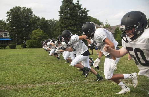 Fenwick players run some sprints as part of conditioning during summer practice. (William Camargo/Staff Photographer)