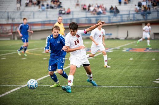 RBHS junior midfielder Dima Aieta, left, and Oak Park and River Forest senior midfielder Max Klevgard square off at midfield in the season opener for both teams. The Bulldogs edged the host Huskies 2-1. (Max Herman/Contributing Photographer)