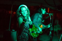 Nancy from the go go dance group The Janes performs alongside The Dyes. | Stacey Rupolo/Contributor