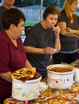 Ellen Soriver does a quality check of the chili made by her group, the North Riverside Administration. | JENNIFER T. LACEY/Contributor