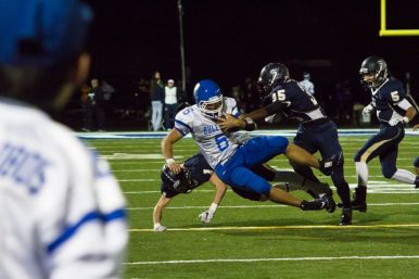 RBHS senior quarterback Ryan Swift is taken down by a couple of Immaculate Conception defenders during the Knights' 15-7 win on Friday, Oct. 2 at the Kennelly Athletic Complex. (Stacey Rupolo/Contributing Photographer)