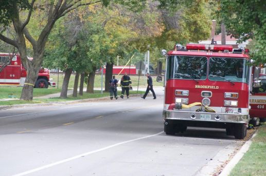 Firefighters and vehicles stage along Maple Avenue south of the BNSF tracks in Brookfield during the HAZMAT event on Oct. 12. (Photo by Deborah Zari/Contributor)