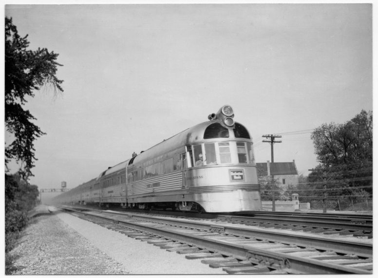 The Denver Zephyr streaks over Salt Creek through Brookfield at close to 100 mph in spring/summer 1937. The old water tower can be seen at lower left and the village hall at right. | Photo courtesy of Chris Stach collection
