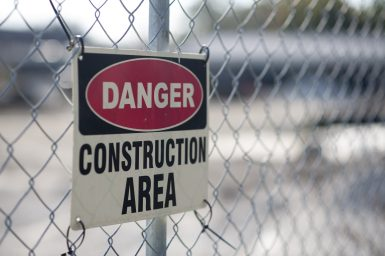 """A sign on a fence near Hollywood School marks a """"construction area"""" where the village of Brookfield wants RBHS to stop work on a track-and-field facility. 