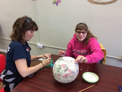 Sarah Cavanaugh (right) works on an arts-and-crafts project during the EAGLES program recently in Brookfield. | Courtesy of SEASPAR