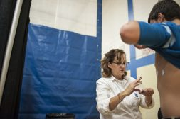 Mandy Connelly prepares a Lyons Township high school student for a heart screening in the school's gymnasium. | William Camargo/Staff Photographer