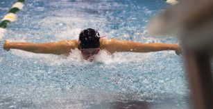 Fenwick senior Erin Scudder rushes to the finish line in the last feet of the 100-yard butterfly race at the 2015 IHSA State Swimming & Diving Championship on Saturday, Nov. 21, 2015. |Jennifer T. Lacey/Contributor