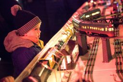 Charming Choo-choo: Hugh Holmes stares, mesmerized, at the toy train display at the Riverside Garage during the 40th Annual Riverside Holiday Stroll in December 2014. | FILE 2014