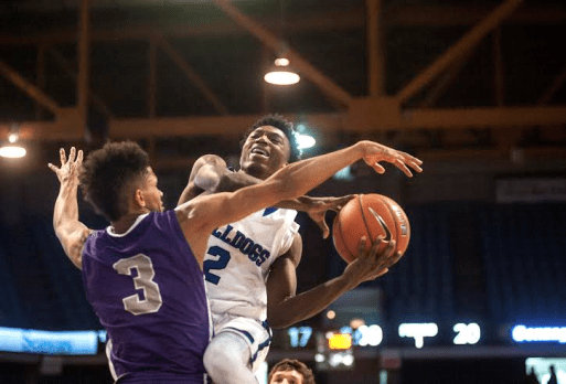 RBHS guard Jalen Clanton drives to the basket against Gonzaga's Prentiss Hubb. The Purple Eagles defeated the Bulldogs 76-64 at the Chicago Elite Classic on Saturday, Dec. 5 at the UIC Pavilion. (William Camargo/Staff Photographer)