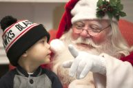 Carmine Boenzi, 3, visited Riverside Bank in downtown Riverside to tell Santa about all the things he wants for Christmas. | Michelle Kanaar/Contributor