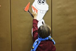 "A child plays ""Pin Olaf's Nose."" 