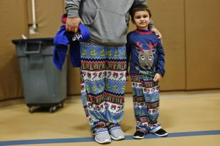 Father and son wear the same pattern pajamas. | Arturo Hidalgo/Contributor