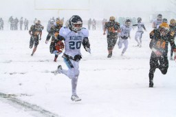 Nazareth senior running back Julian Love had 11 carries and 283 yards and 4 TDs in a 34-0 win over St. Laurence in the Class 5A semifinals. A week later, Nazareth defeated Lincoln-Way West 42-21 to win its second consecutive state title. (File photo)