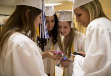 Graduating students of Class of 2015 share their photos on their smartphone while waiting in the hallway before the Commencement Ceremony at Riverside Brookfield High School in Riverside, Illinois, United States of America on May, 22. | Ting Shen/Contributor