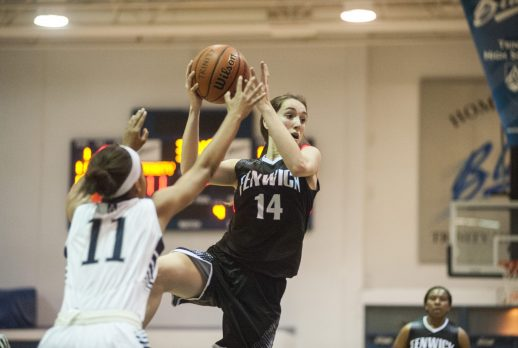 Fenwick sophomore Kate Moore looks for an open teammate while Trinity's Lauren Lee applies defensive pressure. The Blazers beat the Friars 71-54 on Thursday, Jan. 7. (William Camargo/Staff Photographer)