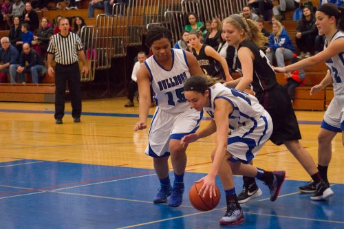 RBHS players Jess JnoBaptiste, reaching for ball, and Lexi Walker have helped solidify the Bulldogs' lineup this season. (File photo)