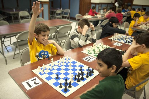 Frank LaMantia raises his hands as he wins his match during the annual St. Mary School Golden Bishops Chess Club and Chess Scholars Chess Tournament on Saturday, Feb. 13. For more photos, visit online at RBLandmark.com