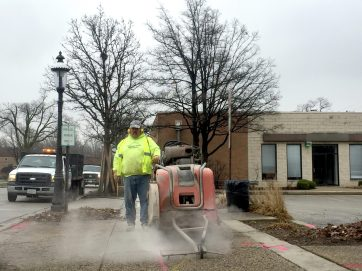 Construction began on the E. Burlington St. streetscape project on March 14 with sawcutting sidewalks. | BOB UPHUES/Staff