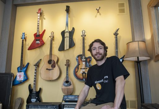 Justin Atwood has operated his guitar shop out of a Broadway Avenue storefront since 2010, repairing and making guitars. | William Camargo/Staff Photographer