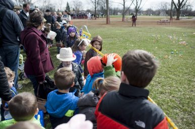 Children await for the caution sign to come down to rush and get eggs during the Brookfield Chamber of Commerce's annual Easter Egg Hunt. | William Camargo/Staff Photographer