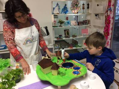 Kathleen Thometz, founder of Doodle Art & Design is helping a student build a resort during spring break camp.
