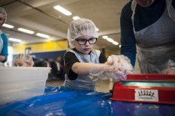 Luke Advancio seals food packages on Sunday April 10, 2016. William Camargo/Staff Photographer