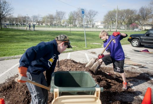 Michael Conray and Drew Swiatek help pour soil to add some more plants at Elhert Park during the Brookfield Beautification Commission's spring Project NICE community-wide cleanup day. | William Camargo/Staff Photographer