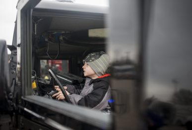 Noah Connerty plays with a police truck during the annual Transportation Exploration Day outside the North Riverside Village Commons on April 28.   William Camargo/Staff Photographer