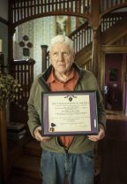 Lew Heine shows off his Purple Heart citation and medal, the result of being wounded in combat in Korea in 1951. | William Camargo/Staff Photographer