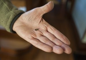 Heine holds a piece of shrapnel removed from his arm by a doctor just recently. | William Camargo/Staff Photographer