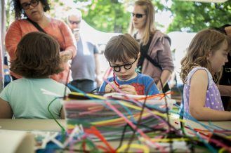 Levi Gagne fashions colorful pipe cleaners into some improvised spectacles and other items. | William Camargo/Staff Photographer